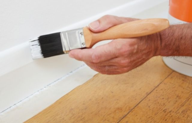 paint oak trim white or replace